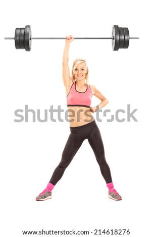 Full length portrait of a strong woman lifting a weight with one hand isolated on white background - stock photo