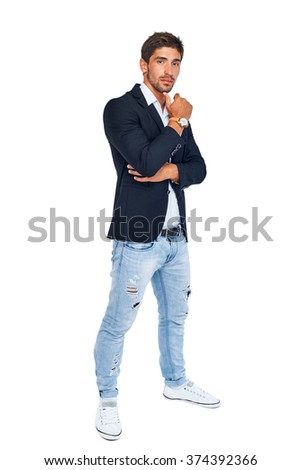 Full length portrait of a stylish young man posing. Isolated on white background