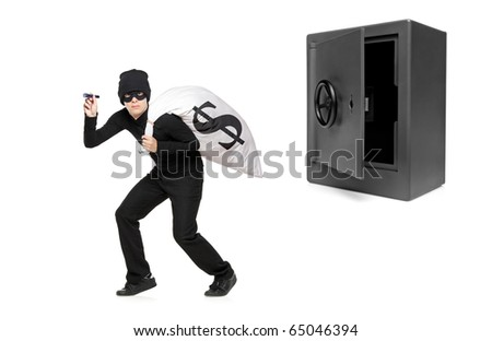 Full length portrait of a thief stealing a money bag from a deposit safe isolated on white background - stock photo