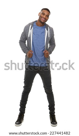 Full length portrait of a trendy young man smiling on isolated white background - stock photo