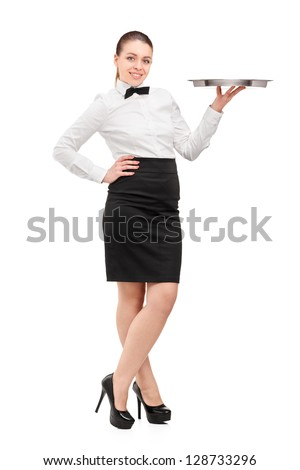 Full length portrait of a waitress with bow tie holding an empty tray isolated on white background - stock photo