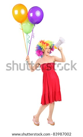 Full length portrait of a woman yelling via a loudspeaker and holding balloons isolated on white background - stock photo