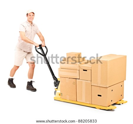 Full length portrait of a worker pushing a fork pallet truck isolated on white background - stock photo