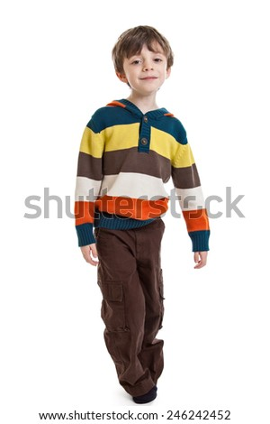 Full length portrait of a 6 year old boy standing wearing a sweater isolated on a white background - stock photo