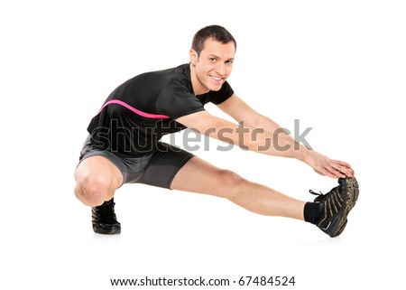Full length portrait of a young athlete exercising isolated against white background