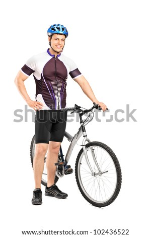 Full length portrait of a young bicyclist posing next to a bicycle isolated on white background - stock photo