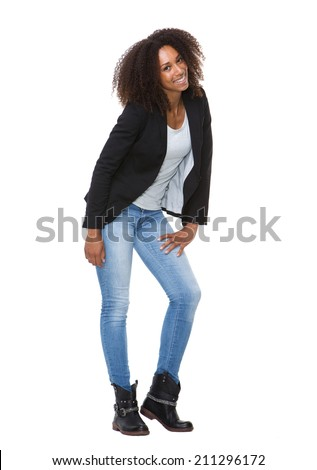 Full length portrait of a young black woman smiling on isolated white background - stock photo