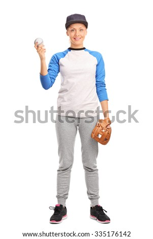 Full length portrait of a young blond woman holding a baseball and looking at the camera isolated on white background - stock photo
