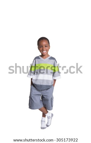 Full length portrait of a young boy with his hands in his pocket - stock photo