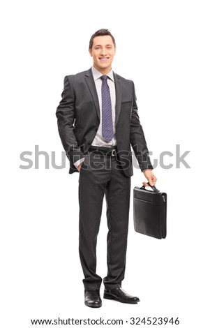 Full length portrait of a young businessman in a gray suit holding a briefcase and looking at the camera isolated on white background - stock photo