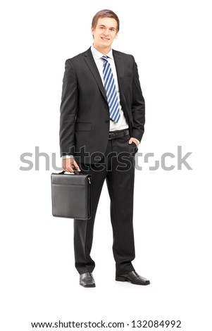 Full length portrait of a young businessman in suit holding a suitcase isolated on white background