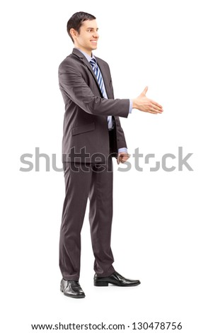 Full length portrait of a young businessman shaking hand isolated on white background - stock photo