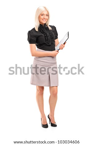 Full length portrait of a young businesswoman holding a clipboard isolated against white background - stock photo
