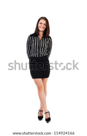 Full length portrait of a young businesswoman standing with crossed legs isolated on white
