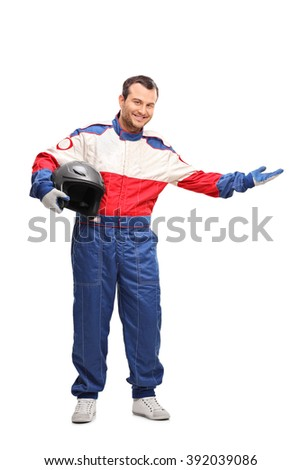 Full length portrait of a young car racer holding a helmet and gesturing with his hand isolated on white background - stock photo