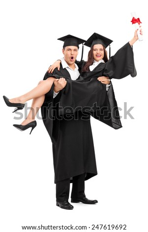 Full length portrait of a young couple celebrating their graduation isolated on white background - stock photo