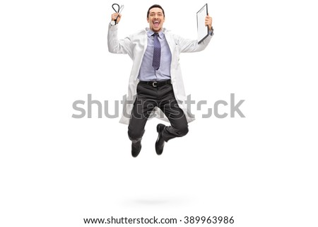 Full length portrait of a young doctor jumping out of joy isolated on white background - stock photo