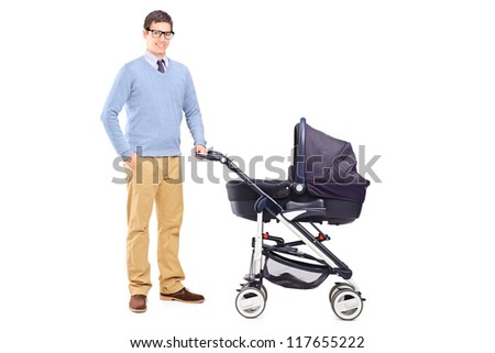 Full length portrait of a young father holding a baby stroller isolated on white background - stock photo