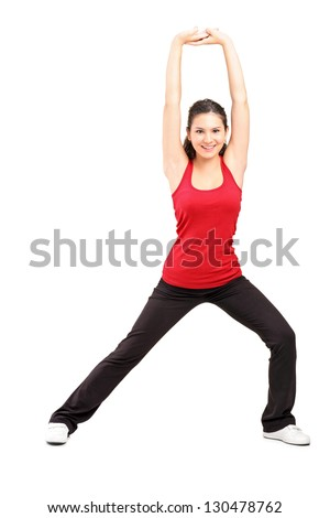 Full length portrait of a young female exercising, isolated on white background