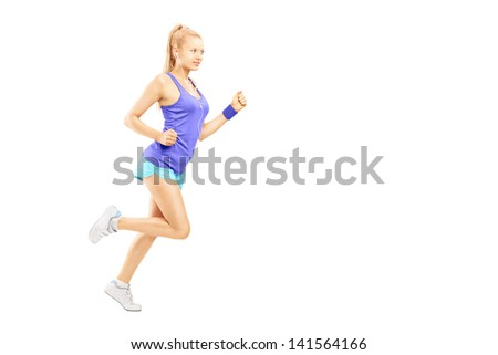 Full length portrait of a young female running isolated on white background - stock photo