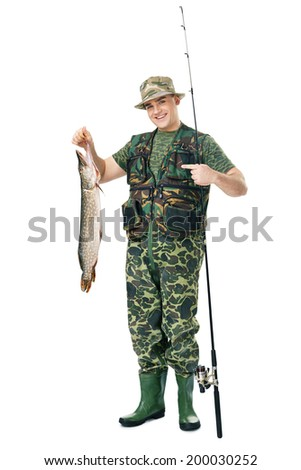 Full length portrait of a young happy fisherman with his catch isolated on white background - stock photo
