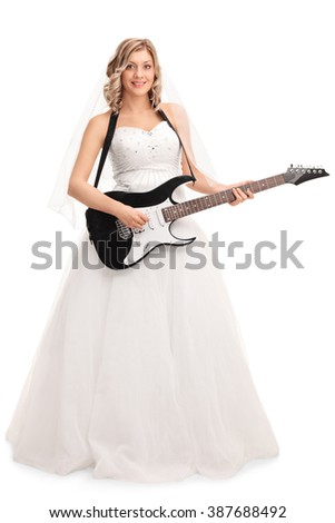Full length portrait of a young joyful bride playing electric guitar isolated on white background - stock photo