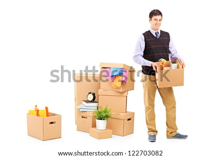 Full length portrait of a young male and moving boxes isolated on white background - stock photo