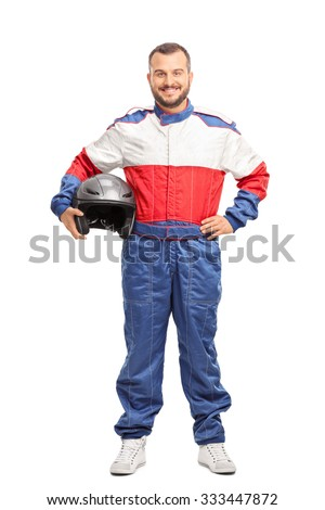 Full length portrait of a young male car racer in overalls holding a helmet and looking at the camera isolated on white background - stock photo