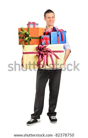 Full length portrait of a young male holding gifts isolated on white background