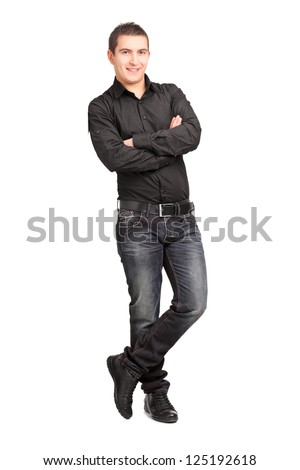 Full length portrait of a young male leaning against wall isolated on white background