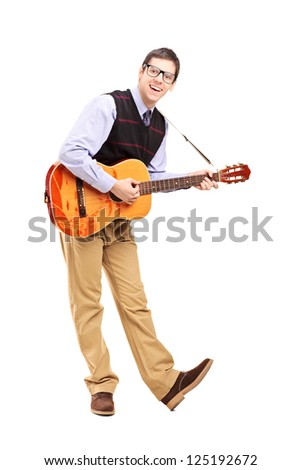 Full length portrait of a young male playing a guitar isolated against white background - stock photo