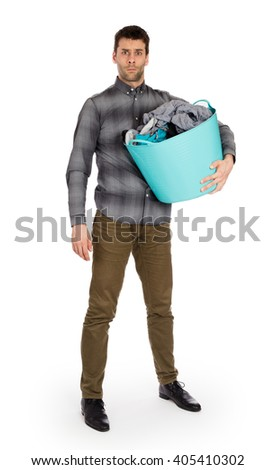 Full length portrait of a young man holding a laundry basket isolated on white background - stock photo