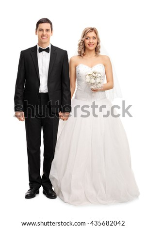 Full length portrait of a young newlywed couple posing isolated on white background - stock photo