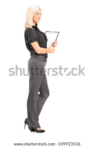 Full length portrait of a young professional woman holding a clipboard, isolated on white background - stock photo