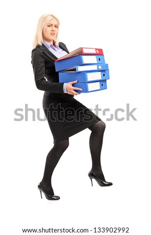Full length portrait of a young professional woman holding folders, isolated on white background