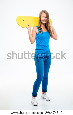 Full length portrait of a young smiling girl holding skateboard isolated on a white background - stock photo