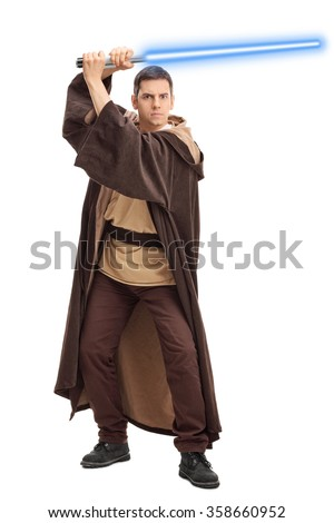 Full length portrait of a young warrior holding a laser sword and looking at the camera isolated on white background - stock photo