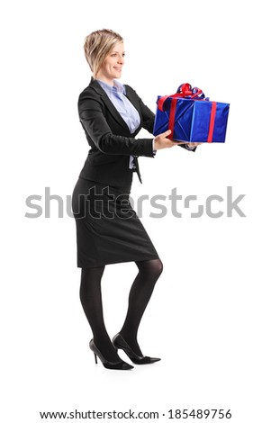 Full length portrait of a young woman holding a present isolated on white background - stock photo