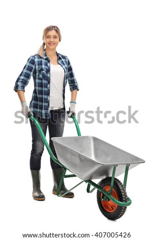 Full length portrait of a young woman posing with an empty metal wheelbarrow isolated on white background - stock photo