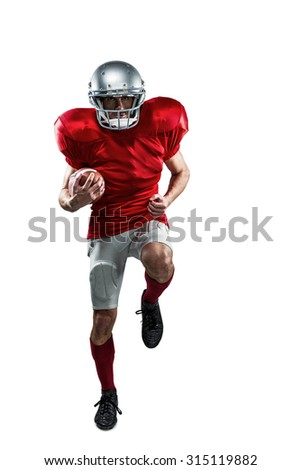 Full length portrait of American football player in red jersey running against white background