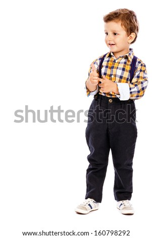 Full length portrait of an adorable little boy showing thumbs up isolated on white - stock photo