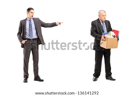 Full length portrait of an angry boss firing an employee, isolated on white background - stock photo
