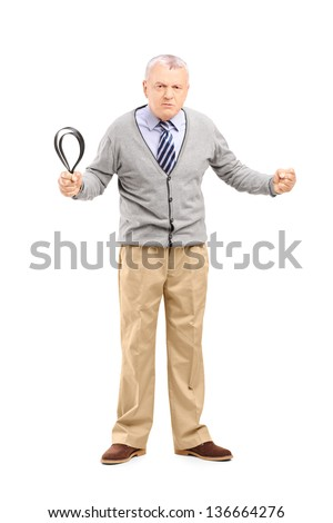 Full length portrait of an angry mature man holding a belt and lookinh at camera isolated on white background - stock photo