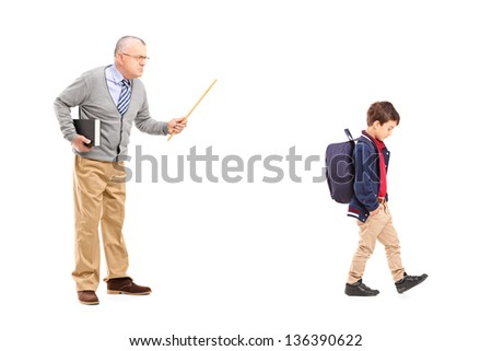 Full length portrait of an angry teacher shouting at a little schoolboy, isolated on white background - stock photo