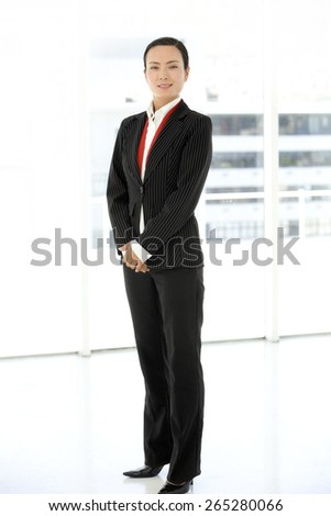 Full length portrait of an Asian Businesswoman - stock photo