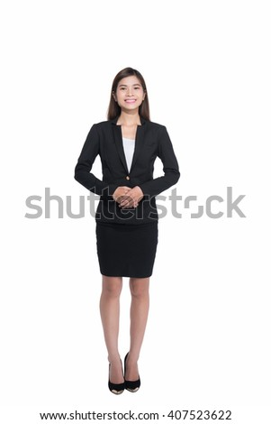 Full length portrait of an attractive businesswoman standing against white background while looking at camera and smiling. - stock photo