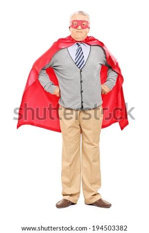 Full length portrait of an elderly in superhero costume isolated on white background - stock photo