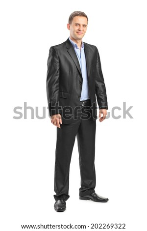 Full length portrait of an elegant man posing isolated on white background - stock photo