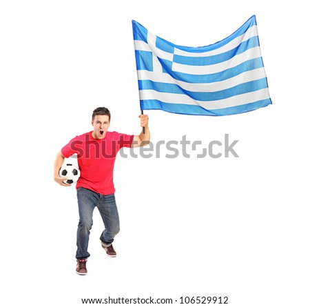 Full length portrait of an euphoric fan holding a ball and flag of Greece isolated on white background - stock photo