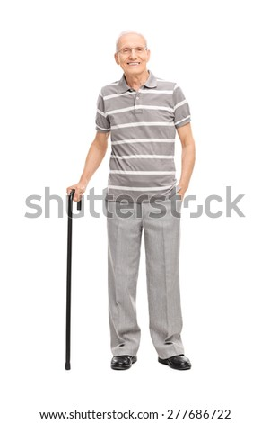 Full length portrait of an old man in a casual polo shirt holding a cane and posing isolated on white background - stock photo